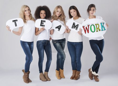 Photo for Women with Teamwork text. Teamwork by multi ethnic group of women - Royalty Free Image