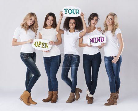 Girls holding Open your mind signs