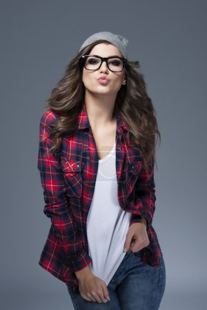 Photo for Stylish young woman wearing glasses. Sweet kisses from hipster girl - Royalty Free Image