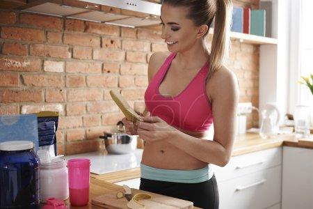 Woman Preparing bananas shake
