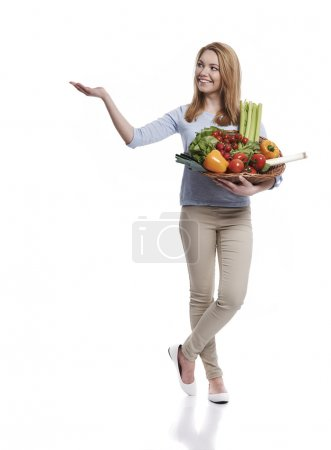Photo for Woman with basket full of healthy food isolated on white background - Royalty Free Image