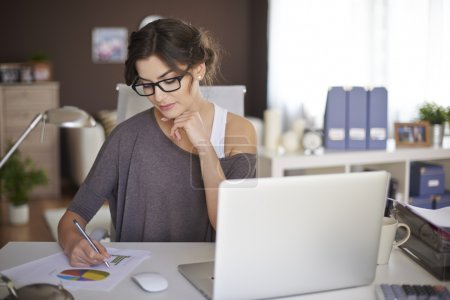 Photo for Portrait of Young woman working at home with a laptop. - Royalty Free Image