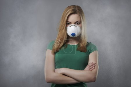 Young woman in air pollution concept