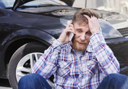 Man with broken car
