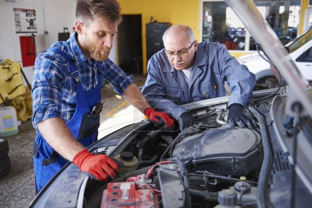 Two mechanics at the service