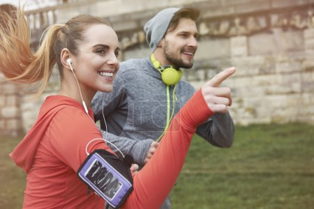 Photo for Fitness couple jogging together outdoors in the morning - Royalty Free Image
