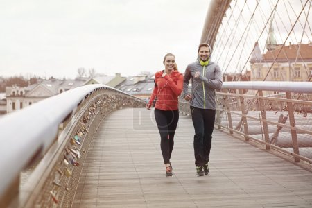 Fitness couple jogging outdoors