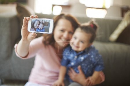 Mother with her daughter taking selfie