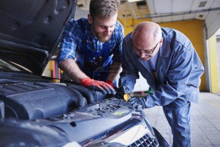 mechanics in car workshop