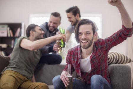Men celebrating the goal.