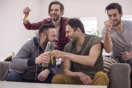 Men celebrating victory of football team