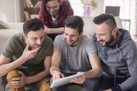 Men using digital tablet