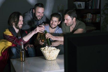 Friends watching soccer match