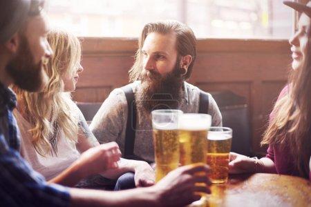 Friends enjoying meeting with beer