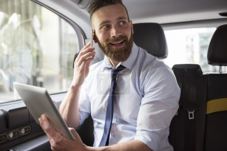 Successful businessman in cab