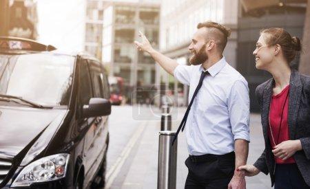 Successful businessman catching cab