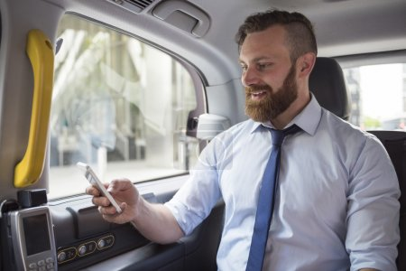 successful businessman in cab