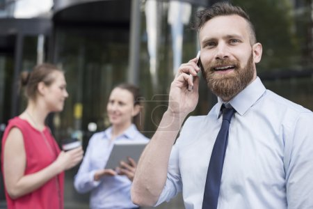 successful businessman talking on phone