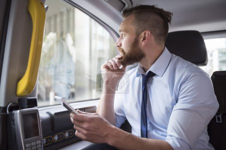 successful business in cab with phone