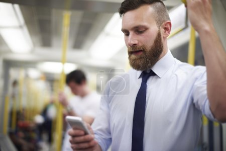 Businessman in subway with phone