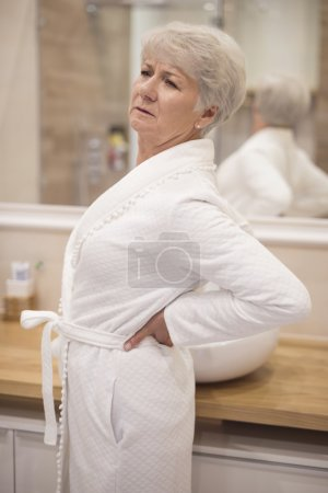 Mature woman with back ache