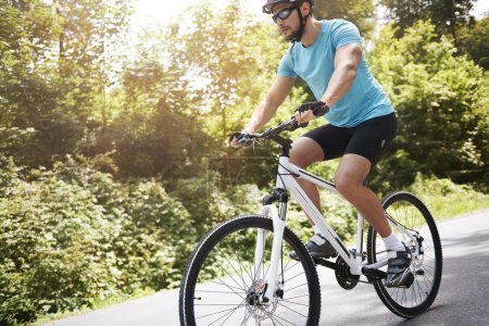 young bicycle rider in forest