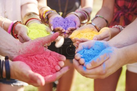 human hands with  colour powders
