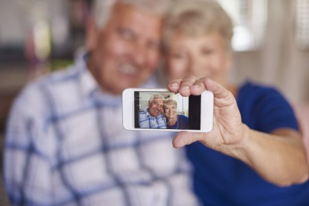 Happy mature couple making selfie