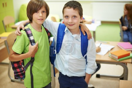 Photo for Two male pupils standing together. It's good to have a friend like him - Royalty Free Image