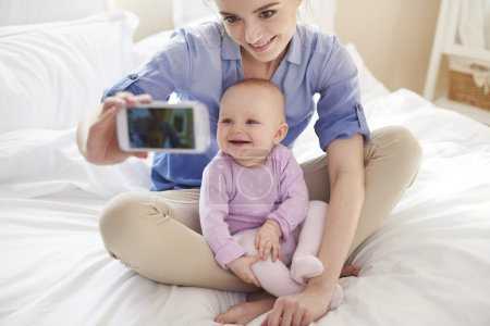 Mother with her baby taking selfie