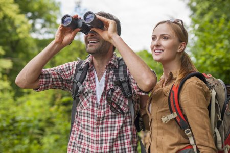 Couple looking on beautiful view in mountain
