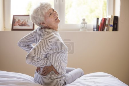 mature woman with backache