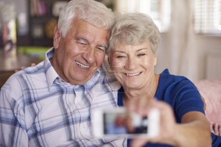 Senior couple making selfie on mobile phone