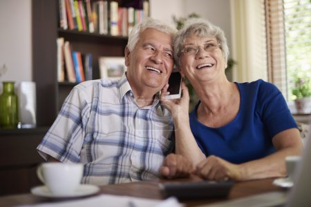 Grandparents talking on the mobile phone