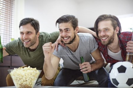 Friends watching championship on TV