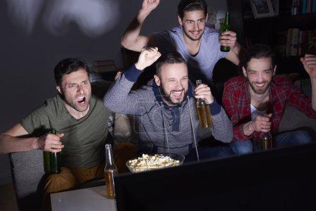 Men watching a soccer match