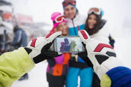 Friends taking selfie in the mountains