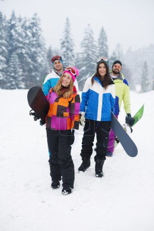 Best friends Preparing for snowboarding