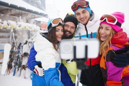 Friends taking selfie on the ski slope