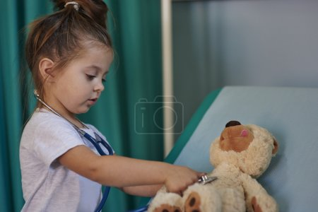 Girl playing a doctor