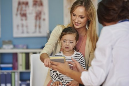 Mother and daughter visit a doctor