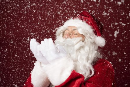 Photo for Santa Claus brings snow. Snow is falling all around me - Royalty Free Image