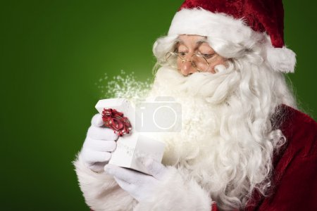 Photo for Santa Claus open gift box.. Christmas is the time when wonders happen - Royalty Free Image