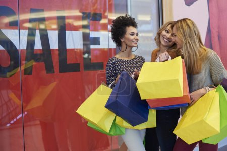 Photo for Women in Shopping mall, shopping with friends, with paper bags - Royalty Free Image