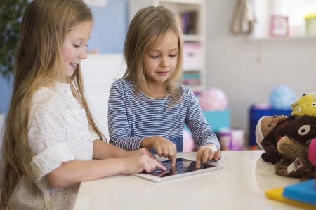 Girls playing with tablet