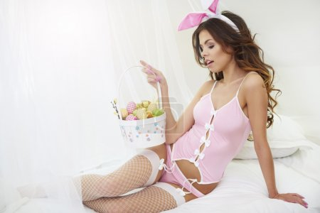 woman in pink rabbit costume
