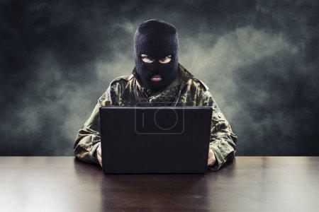 Cyber terrorist in military uniform