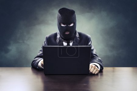 Business espionage hacker or government agent stealing secrets