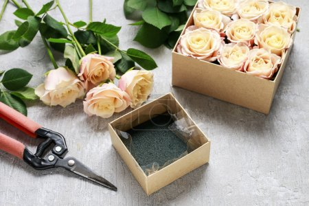 Florist workplace: how to make box with flowers, step by step