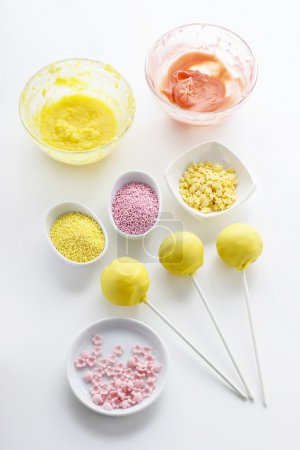 Photo for Yellow cake pops isolated on white background. Party dessert - Royalty Free Image